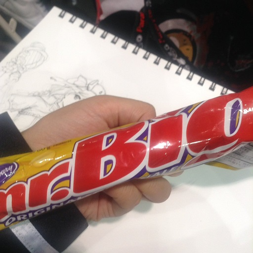 Pictured: Mr. Big candy bar. In the background, I was attempting to draw and line a doodle.