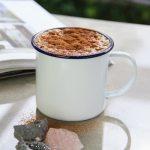 Mug of dandelion coffee on a table top