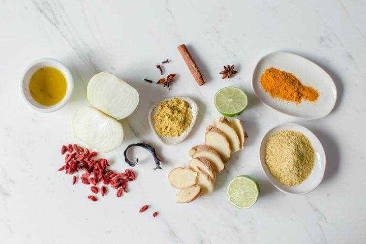 Ingredients used in a vegan broth to make Pho, in a lay over a white marble tile