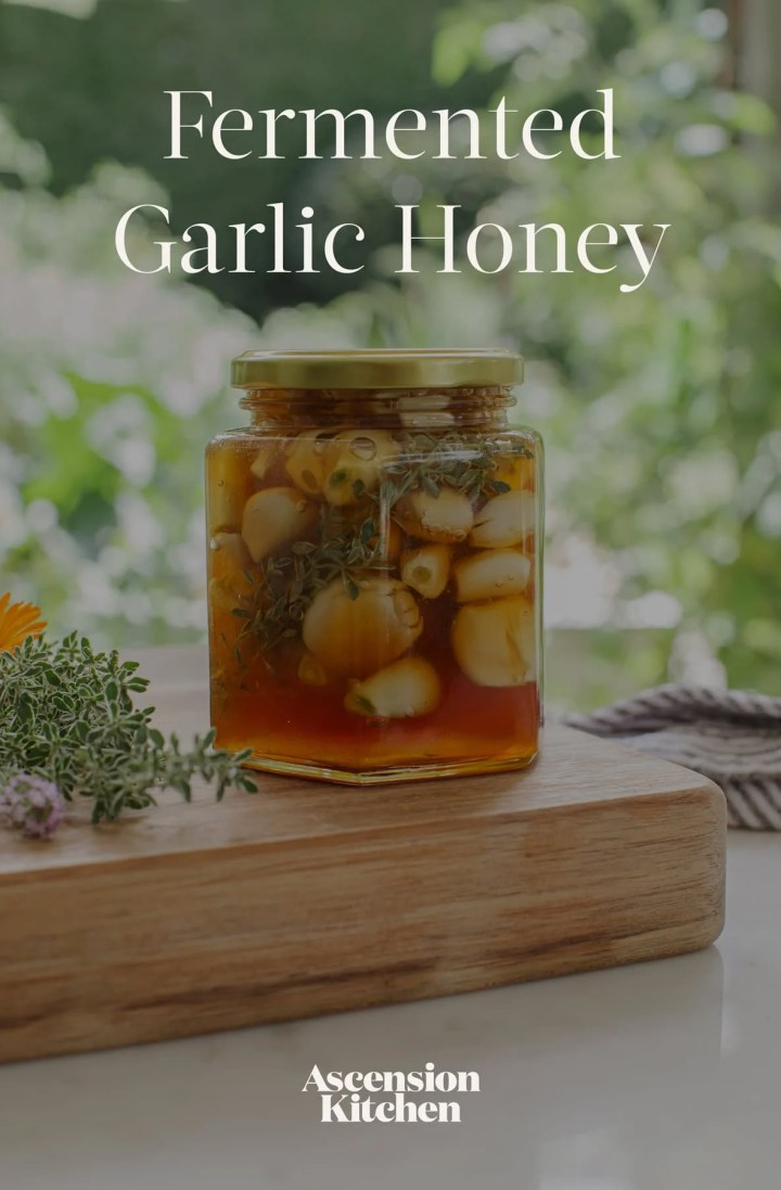 Fermented Garlic Honey in a jar on a marble surface