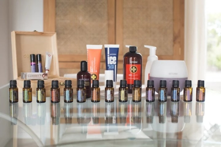 The doTERRA Nature's Solutions Kit laid out beautifully on a glass table