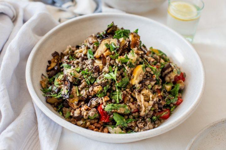 Colourful eggplant salad in a ceramic bowl