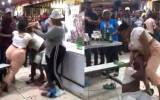 South African woman beats up her Husband after catching him with a side chick (video) 4
