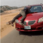 (Video) Policeman spotted on bonnet of speeding vehicle of lady who refused to stop for security operatives who were not wearing face masks (video) 1