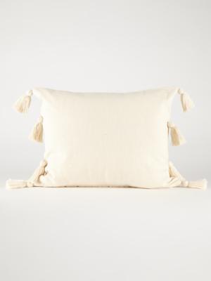 white cotton tassel cushion