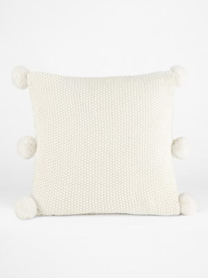 white pompom knitted cushion