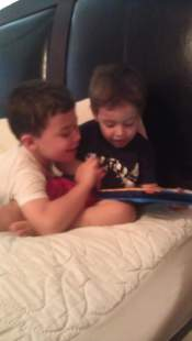 Reading with his cousin Jordan