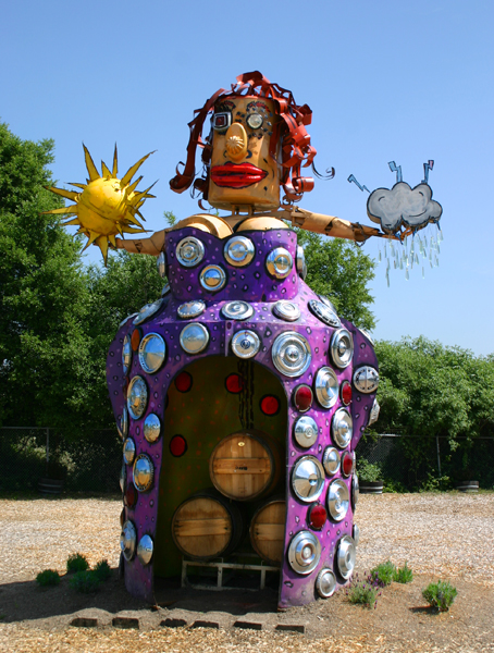 A Goddess with wine barrels in herskirt.