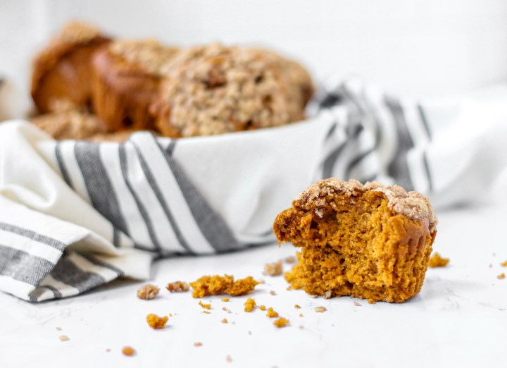 pumpkin muffin with bite taken out to see the inside texture of the pumpkin muffin