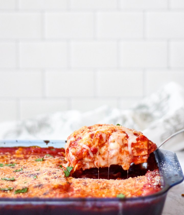 lasagna being pulled from casserole dish