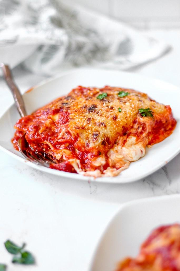 Closeup shot of one plate of lasagna.