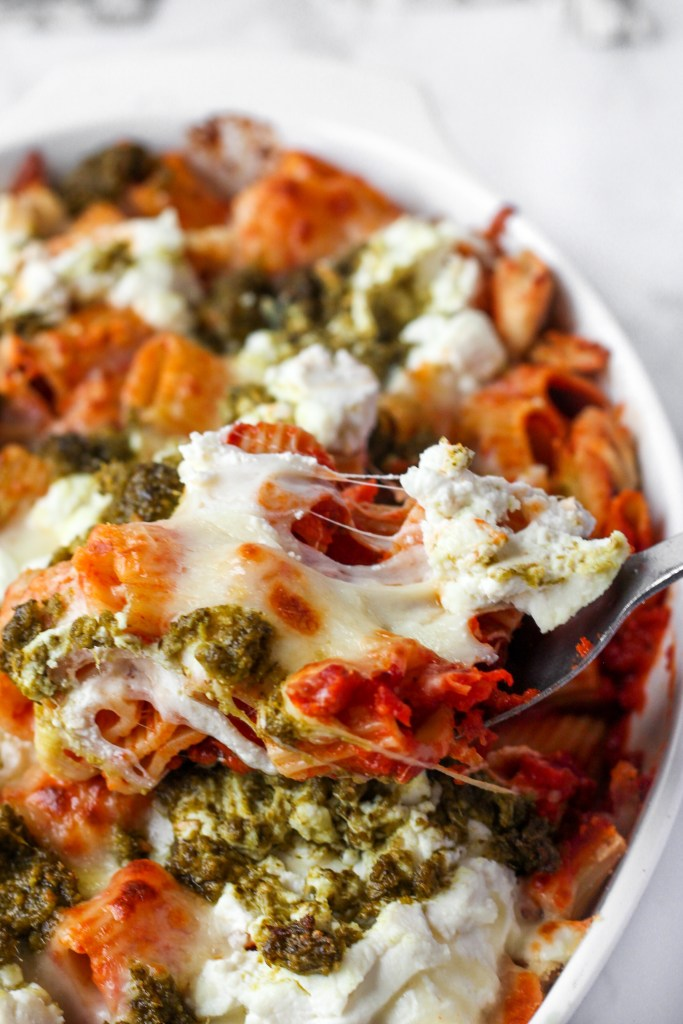 Scooping the Pesto Ricotta Baked Rigatoni