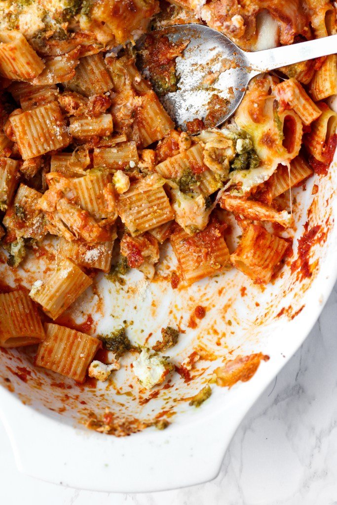 casserole dish with spoon of Pesto Ricotta Baked Rigatoni