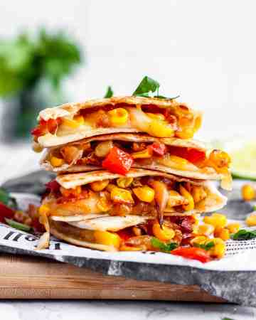 A stack of red pepper and corn vegetarian quesadillas.
