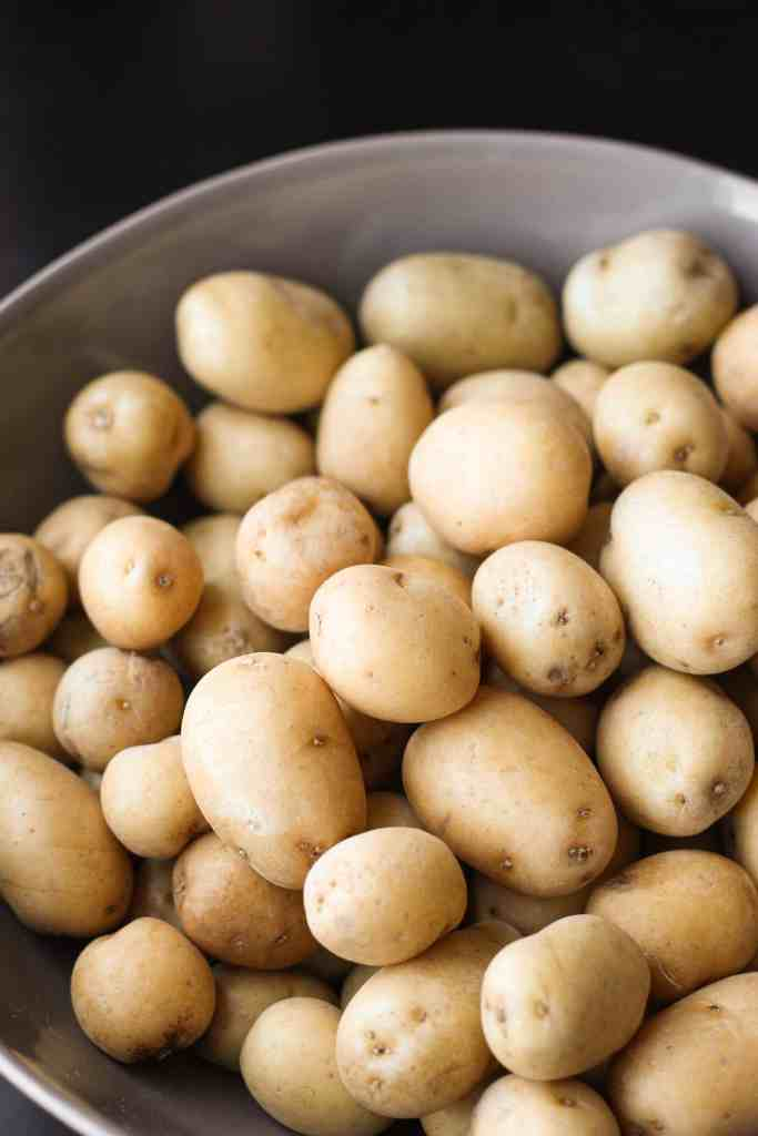 a grey bowl holding the peewee potatoes