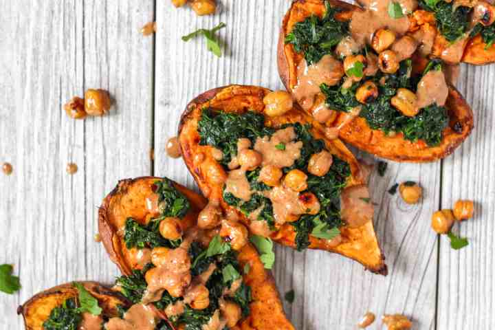 overhead shot of stuffed roasted sweet potatoes with spinach and crispy chickpeas.