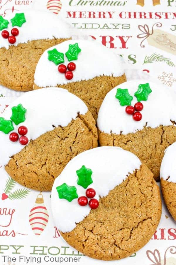 round gingerbread cookies with white frosting and holly decoration.