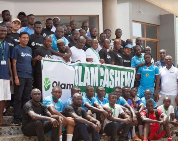 A section of Olam staff and management, with Country Head second from left on standing row