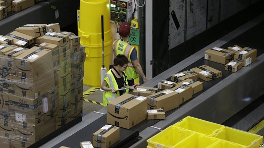Packages move down a conveyor system were they are directed to the proper shipping area