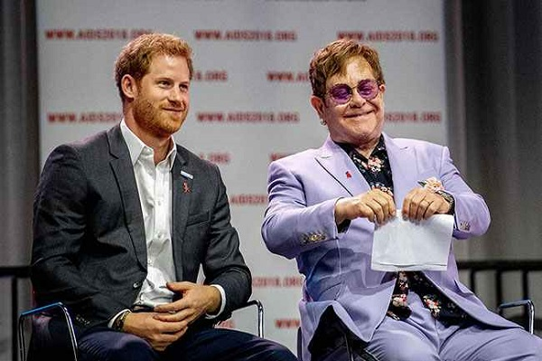 Prince Harry (L) and Elton John (R) appeared on stage together during the AIDS conference.