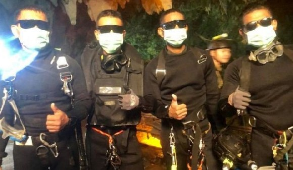 Three Thai navy divers and a medic, who stayed with the group while the rescue took place