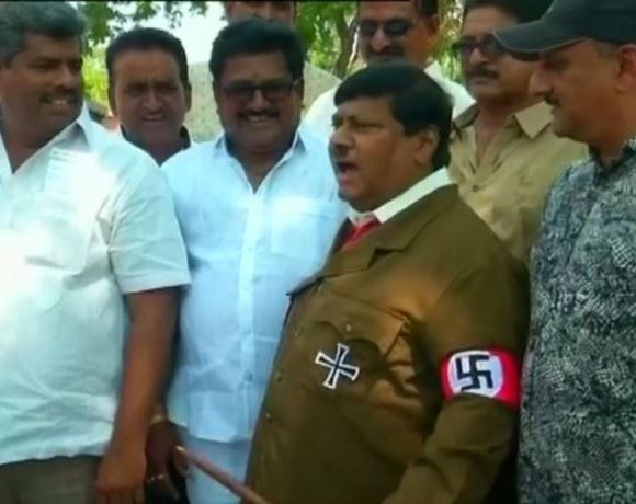 MP dressed as Hitler