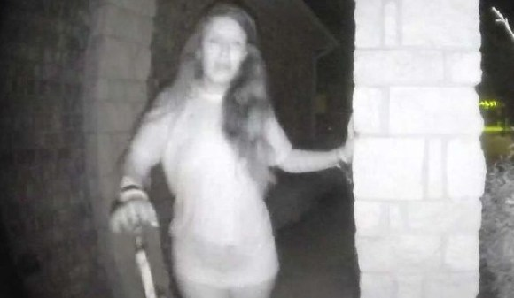 The mystery woman was filmed ringing a doorbell in Texas