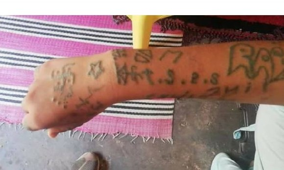 The young woman said her captors forcibly tattooed her and burnt her with cigarettes