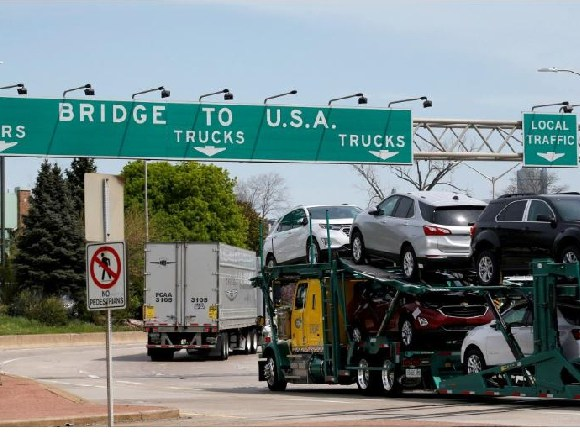 A car hauler heading for Michigan, drives on the lane to Ambassador Bridge in Windsor, Ontario