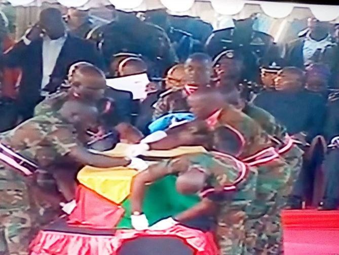 Casket of Kofi Annan wrapped in GH flag