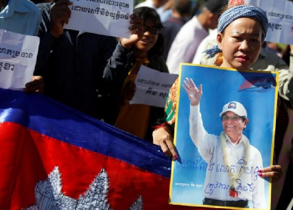 Supporters of Kem Sokha, leader of the Cambodia National Rescue Party stand outside the Appeal Court