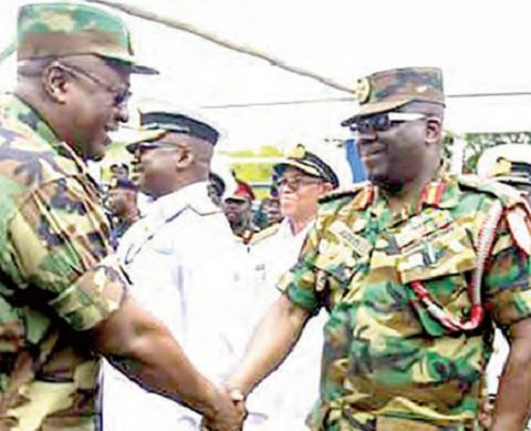 Mahama in a hand shake with Major General Sampson Adeti