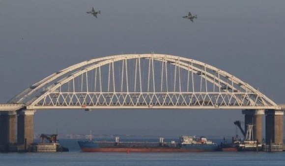 A tanker under the bridge shut all navigation from and into the Sea of Azov