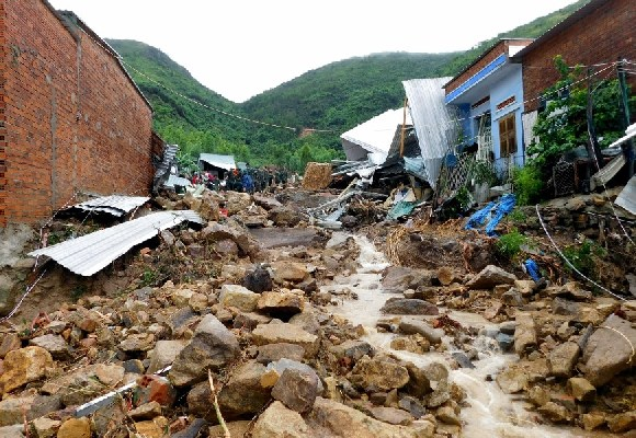 At least 12 people have been killed by the flood and landslide