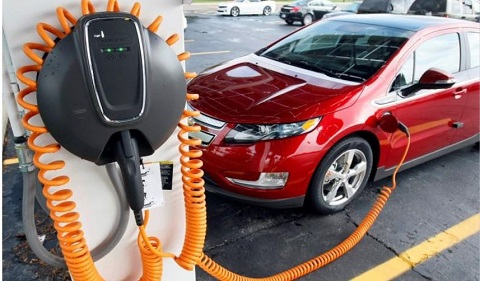 File; Chevrolet Volt electric vehicle is parked at the solar-powered electric charging station