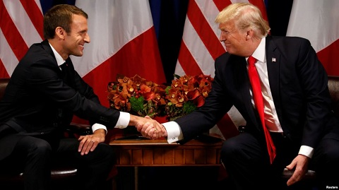 French President, Macron (Left) in a handshake with U.S President, Donald Trump (Right)