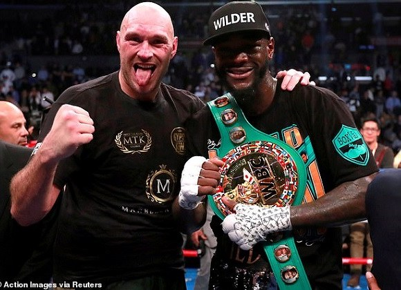 9057568-6642347-Deontay_Wilder_right_says_his_rematch_with_Tyson_Fury_is_almost_-a-31_1548720302680