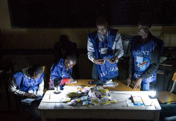 Agents counting the ballot papers