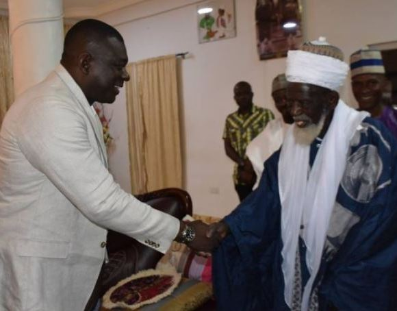 IGP shakes hands with Chief Imam