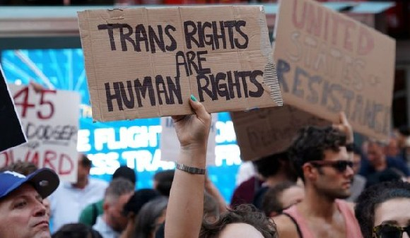 People protest President Trump's announcement of plans to reinstate a ban on transgenders