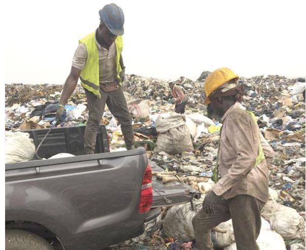 Personnel destroying the seized items
