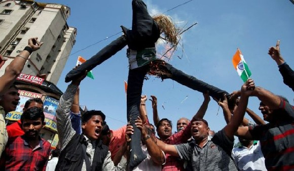 Some Indians took to the streets, burning an effigy of Pakistan, after news of the air strikes broke
