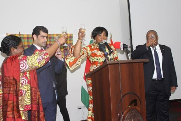 Micheal Ashwin Adhin with Sherly Ayorkor Botcway and others proposing a toast
