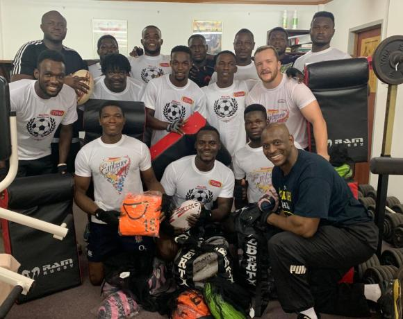 Mr Herbert Mensah, Prseident of Ghana Rugby, with Ghana rugby players during a gym session in Accra Ghana when the kit was outdoored