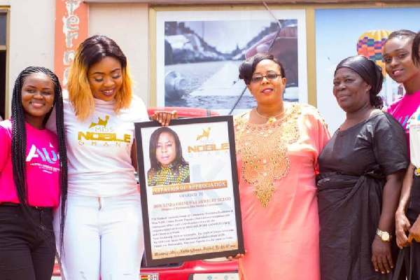 Organizers of Miss Noble presenting a citation to the MP for Shai-Osudoku