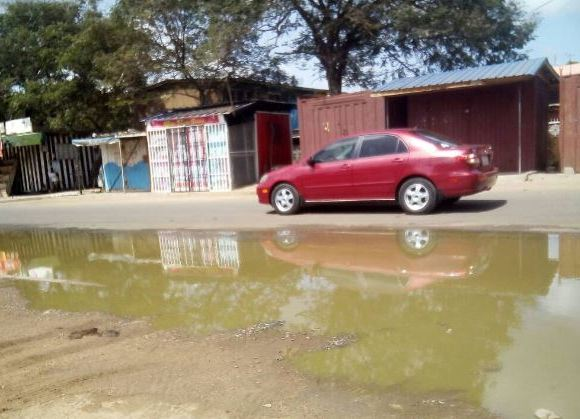 waste water from the system seeps through the streets of Tema