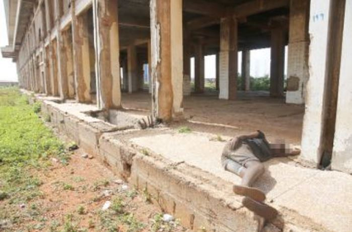A mentally sick person taking a rest at the defunct Meridian Hotel at Community 1 in Tema