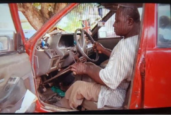 His car has been adapted with hand controls
