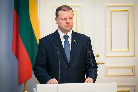 Mr Skvernelis, seen here with his partner and children, said he would resign his post on 12 July
