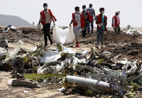 Red Cross workers carry body bag with the remains of Ethiopian Airlines Flight ET 302 crash victims